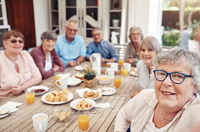 Buy stock photo Cropped portrait of a happy senior woman sitting with her friends and taking a selfie during a tea party