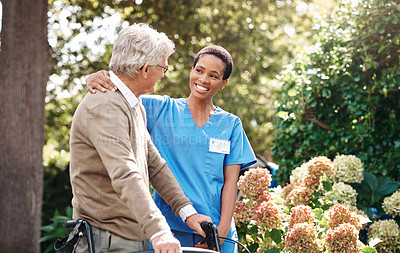Buy stock photo Cropped shot of an attractive young nurse helping her senior patient walk with his walker during a day outdoors
