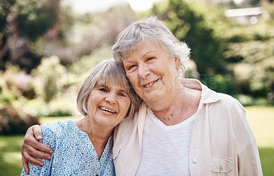 Buy stock photo Cropped portrait of two senior women holding each other during a day out in the garden