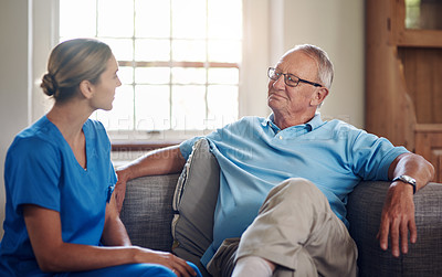 Buy stock photo Shot of a senior man being cared for by a young nurse at home