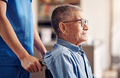 Buy stock photo Shot of a senior man in a wheelchair being cared for by a nurse at home