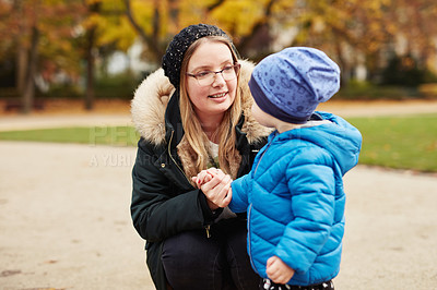 Buy stock photo Cropped shot of an affectionate young mother spending time with her son in a park in autumn
