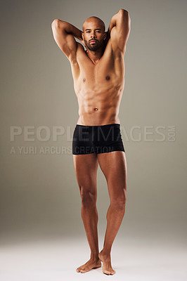 Buy stock photo Full length shot of a handsome young man posing in underwear against a grey background