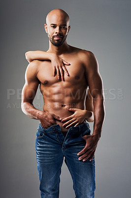 Buy stock photo Portrait of a handsome young man posing shirtless against a grey background