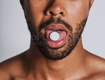 Buy stock photo Cropped shot of an an unrecognizable man taking medication against a grey background