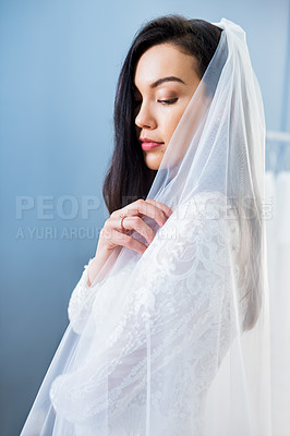 Buy stock photo Cropped shot of a beautiful young bride wearing her wedding dress in her dressing room
