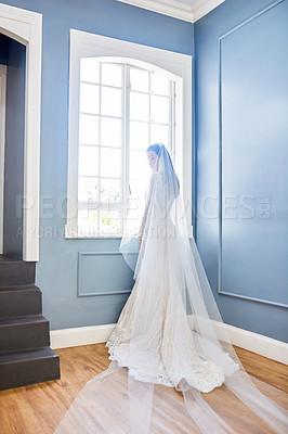 Buy stock photo Full length shot of a beautiful young bride wearing her wedding gown in her dressing room