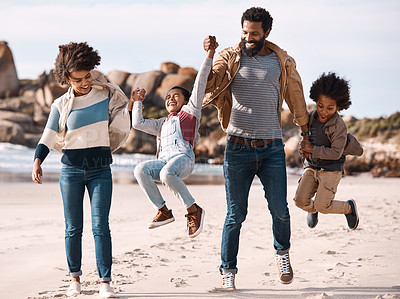 Buy stock photo Shot of an adorable little boy and girl going having fun at the beach with their parents