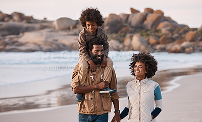 Buy stock photo Shot of a happy young family going for a walk along the beach