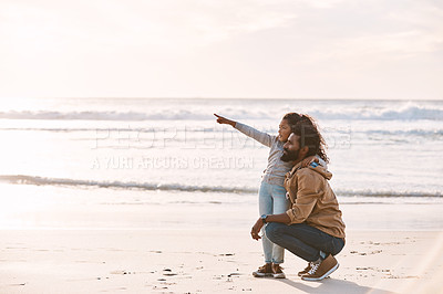 Buy stock photo Shot of an adorable little girl having a fun day at the beach with her father