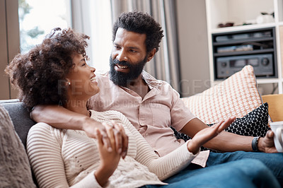 Buy stock photo Cropped shot of an affectionate couple relaxing on the sofa at home