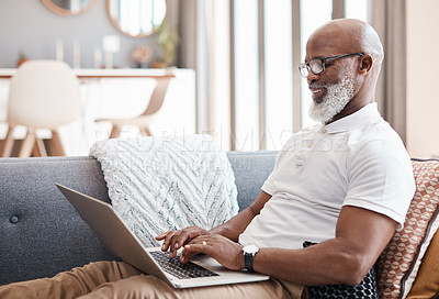 Buy stock photo Shot of a mature man using a laptop at home