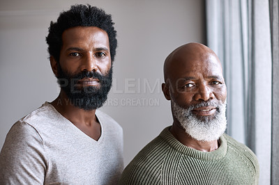 Buy stock photo Portrait of a handsome young man posing next to his father at home