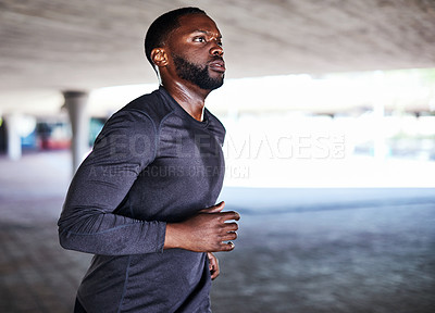 Buy stock photo Cropped shot of a handsome young male athlete working out in the city