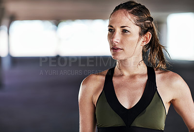 Buy stock photo Cropped shot of an attractive young female athlete working out in the city