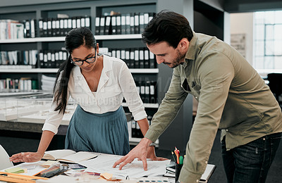Buy stock photo Cropped shot of two young architects working together in a modern office
