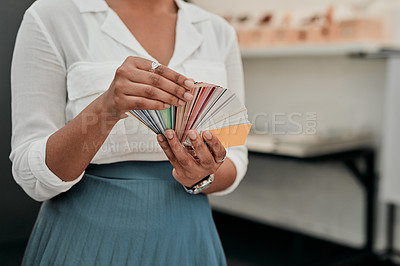 Buy stock photo Cropped shot of an unrecognizable architect looking at a color swatch while standing in her office