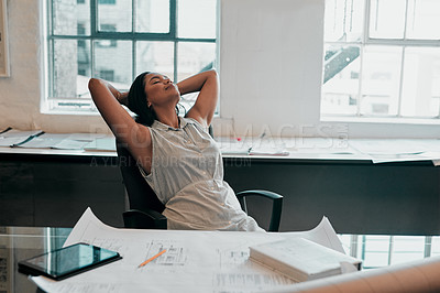 Buy stock photo Cropped shot of a female architect looking relaxed at her desk