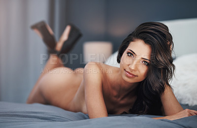 Buy stock photo Full length portrait of a gorgeous young woman lying nude on her bed at home