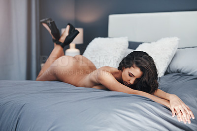 Buy stock photo Full length shot of a gorgeous young woman lying nude on her bed at home