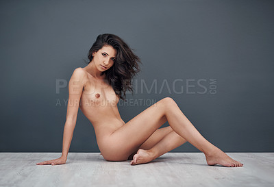 Buy stock photo Studio portrait of a gorgeous young woman posing nude against a grey background
