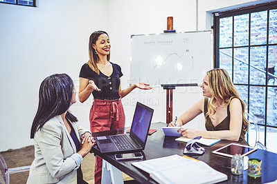 Buy stock photo Shot of a businesswoman giving a presentation to her colleagues in an office