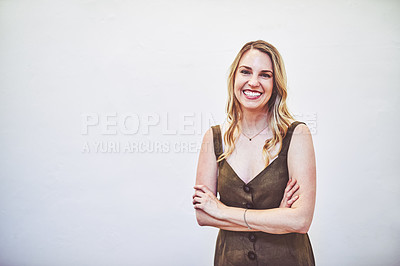 Buy stock photo Studio portrait of a young businesswoman standing against a white background