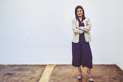 Buy stock photo Portrait of a mature businesswoman standing against a white background
