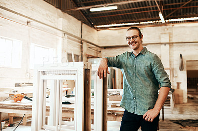 Buy stock photo Portrait of a happy young carpenter posing inside a workshop