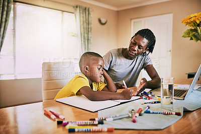 Buy stock photo Cropped shot of a little boy looking upset while doing his homework with his dad at home
