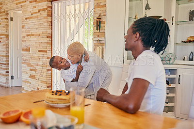 Buy stock photo Cropped shot of an attractive young woman hugging her son during breakfast with her family at home