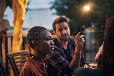 Buy stock photo Shot of young friends having a dinner party outdoors