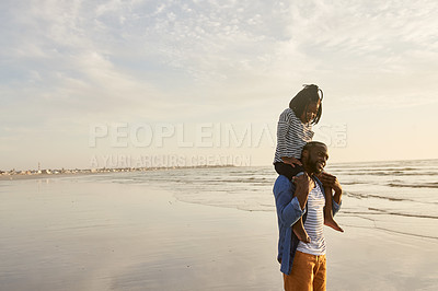 Buy stock photo Shot of a young man spending time at the beach with his adorable daughter