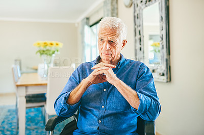 Buy stock photo Cropped shot of a senior man looking thoughtful while sitting in his wheelchair in a retirement home