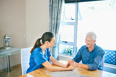 Buy stock photo Cropped shot of a senior man smiling while talking to a female nurse in a nursing home