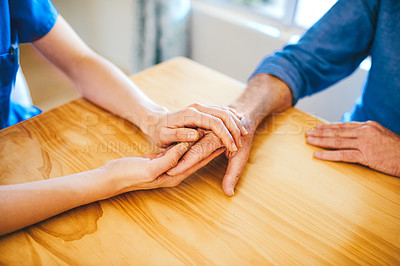 Buy stock photo Cropped shot of an unrecognizable female nurse consoling a senior man in a nursing home