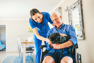 Buy stock photo Cropped shot of a senior man showing a female nurse his dog in a nursing home