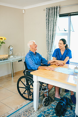 Buy stock photo Full length shot of an attractive young female nurse laughing with a senior man at a nursing home