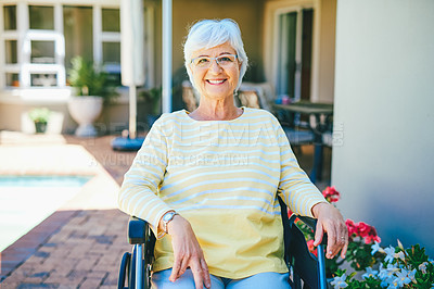 Buy stock photo Cropped portrait of a cheerful senior woman smiling while sitting in her wheelchair outdoors at a retirement home