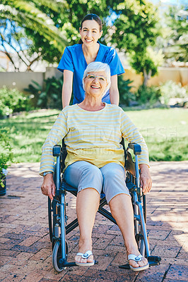 Buy stock photo Full length portrait of a senior woman smiling while outdoors with a female nurse at a nursing home