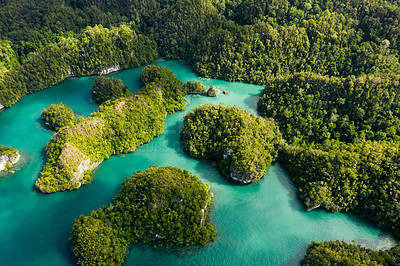 Buy stock photo High angle shot of beautiful green islands in the vast oceans of Indonesia