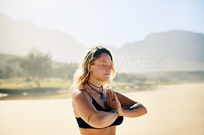 Buy stock photo Cropped shot of a beautiful young woman practising yoga on the beach