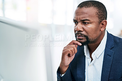Buy stock photo Shot of a mature businessman working on a computer in an office