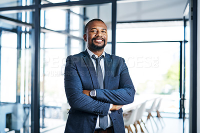 Buy stock photo Cropped portrait of a handsome middle aged businessman smiling while standing with his arms folded in a modern office
