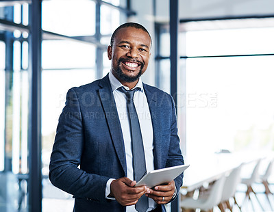 Buy stock photo Cropped portrait of a handsome middle aged businessman smiling while holding a digital tablet in a modern office