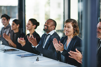 Buy stock photo Cropped shot of a diverse group of young businesspeople applauding during a conference