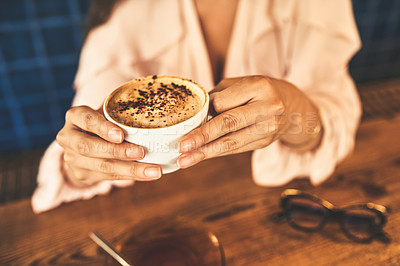 Buy stock photo Cropped shot of an unrecognizable woman having coffee in a cafe