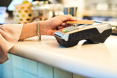 Buy stock photo Cropped shot of an unrecognizable woman making a card payment in a restaurant
