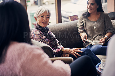 Buy stock photo Shot of a group of women attending a book club meeting at a bookstore