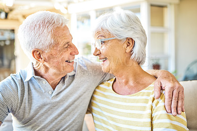Buy stock photo Shot of a happy senior couple relaxing together in the backyard at home